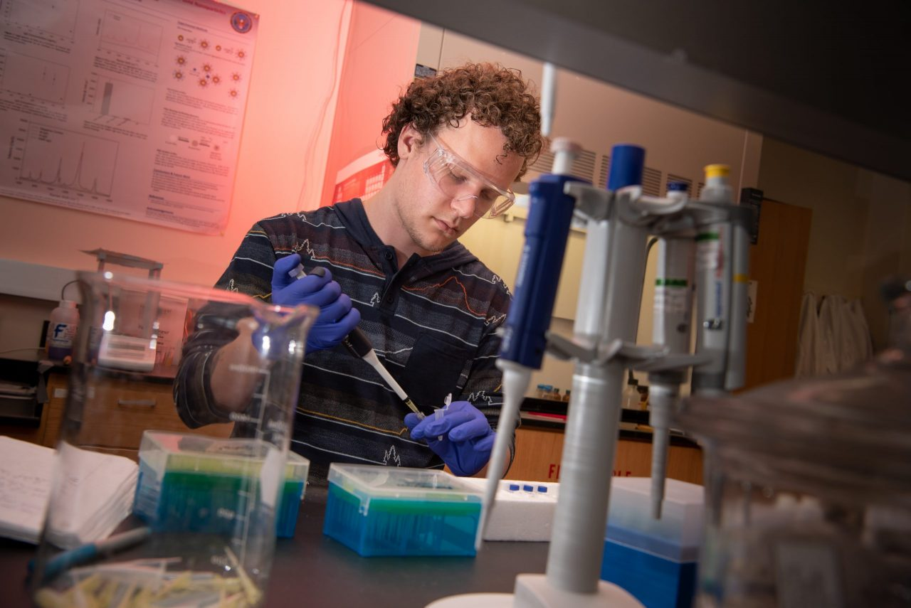 Evan Strandquist at work in the Science Lab Building