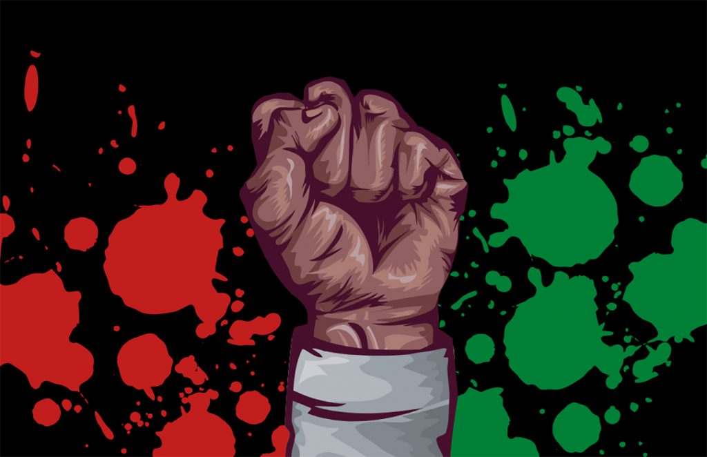 fist amid splashes of paint