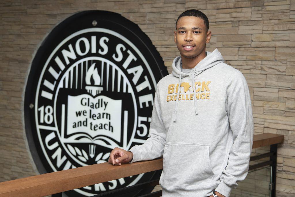 Jaden Echols in front of the ISU logo in the Bone Student Center
