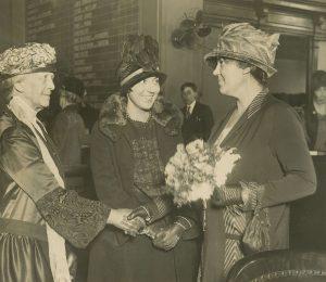 Florence and Gertrude Bohrer shaking hands