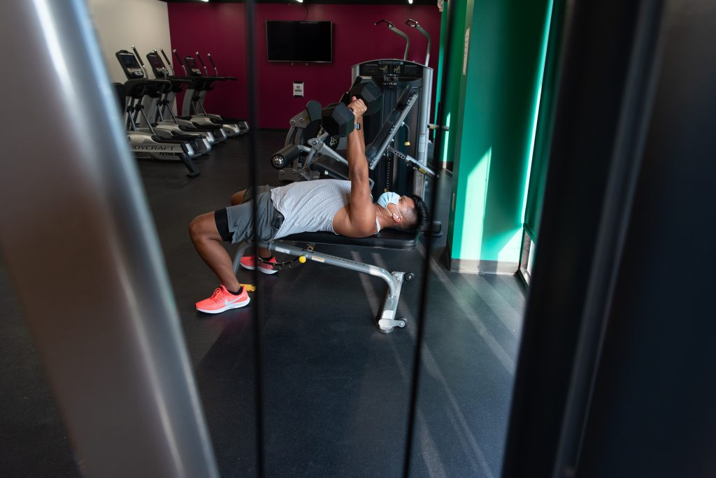 Micor lifts weights in the gym at his apartment complex, The Edge.