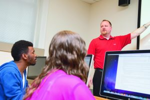 Dr. Caleb T. Carr, associate professor in the School of Communication at Illinois State University, teaches a class.
