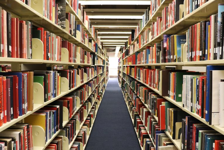 two rows of books on shelves at Milner Library