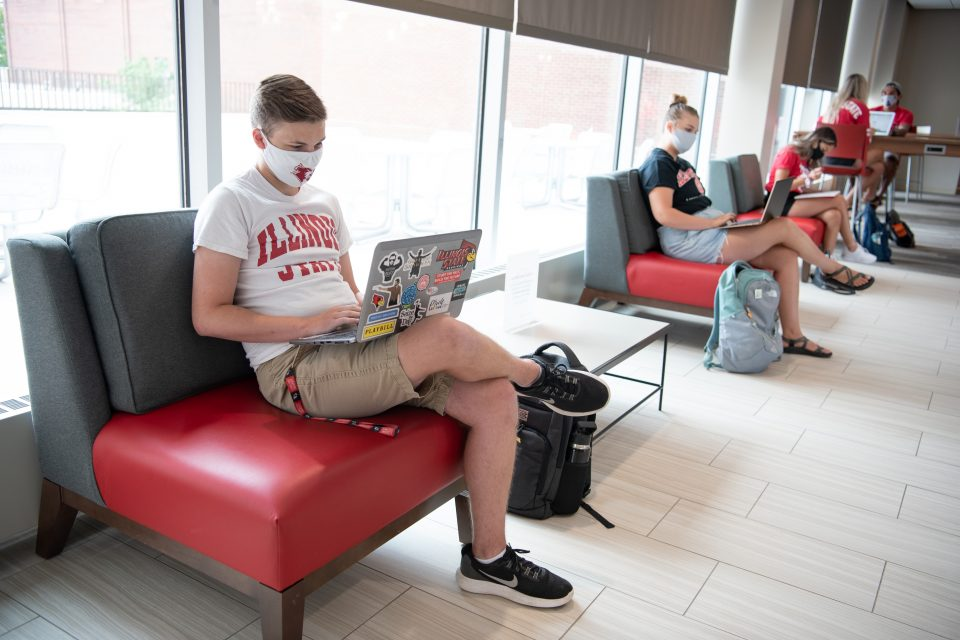Students with facial coverings distance in the Bone Student Center