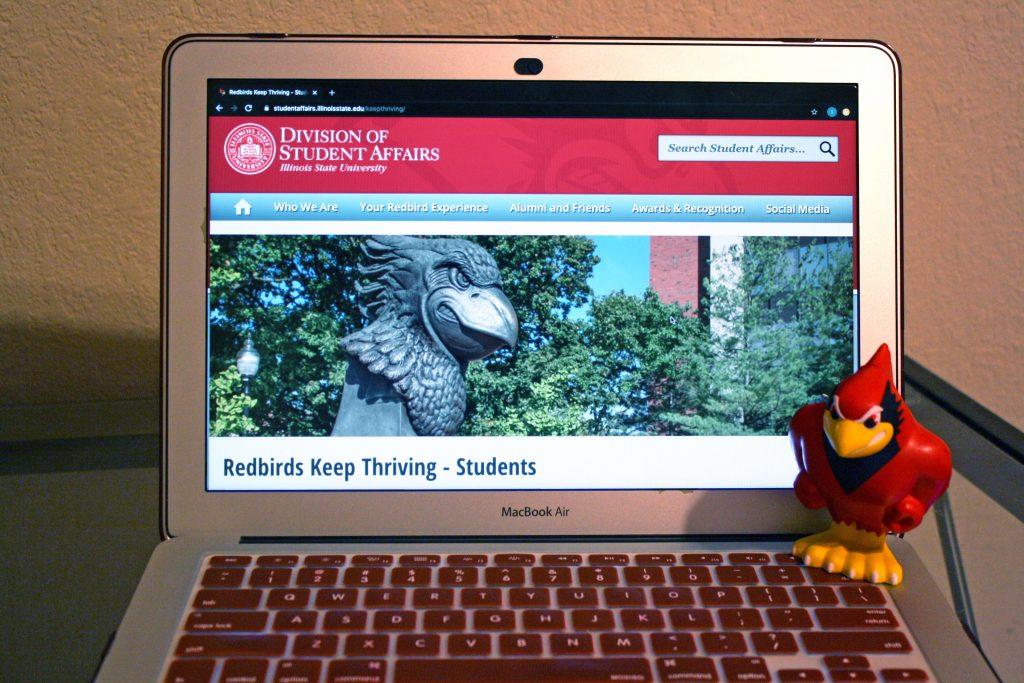 Laptop open to Redbirds Keep Thriving website.