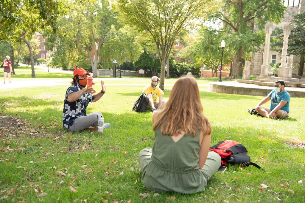 Professor leads class in an outdoor setting