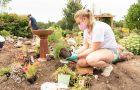 Student planting in Horticulture Center garden