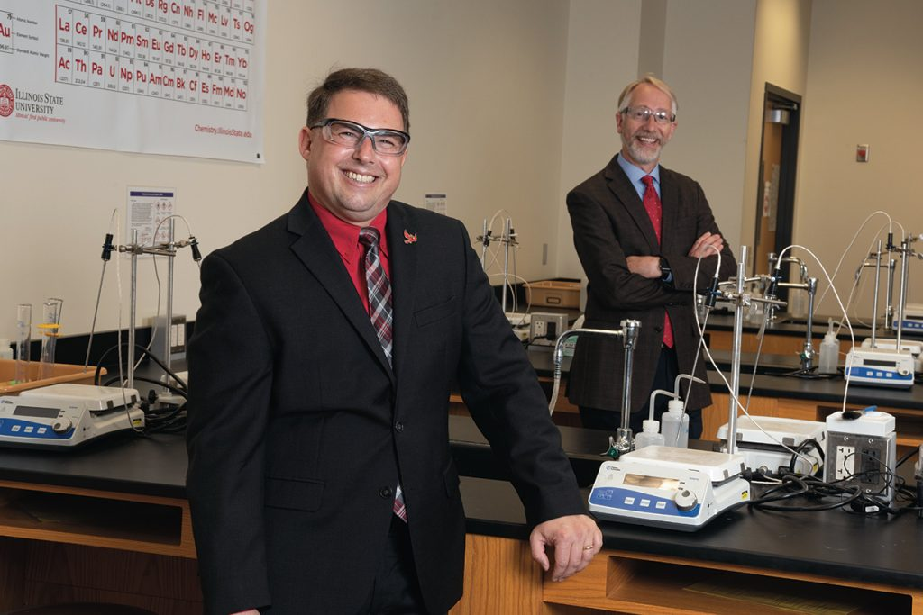 Dr. Craig C. McLauchlan (left) has taken over as associate vice president for Research and Graduate Studies from fellow Department of Chemistry colleague Dr. John Baur.
