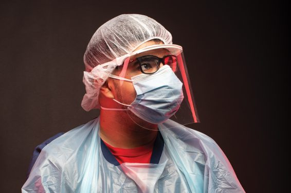 Angel Pulido in mask and nurse scrubs
