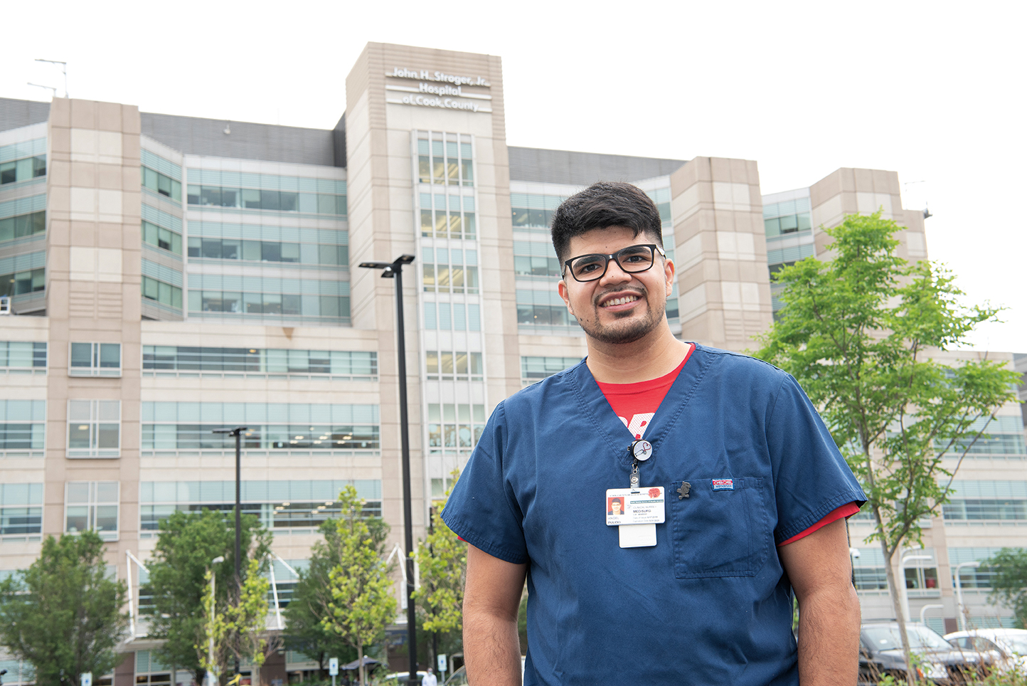 Angel Pulido standing in front of a hospital