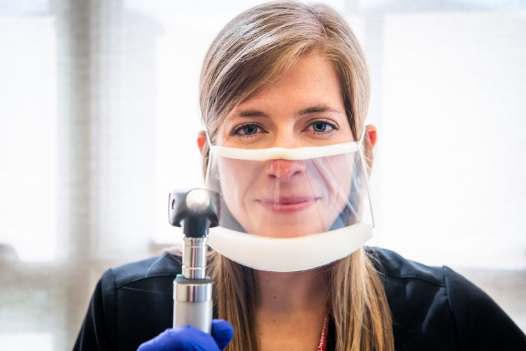 Graduate student with see-through mask in speech and hearing clinic