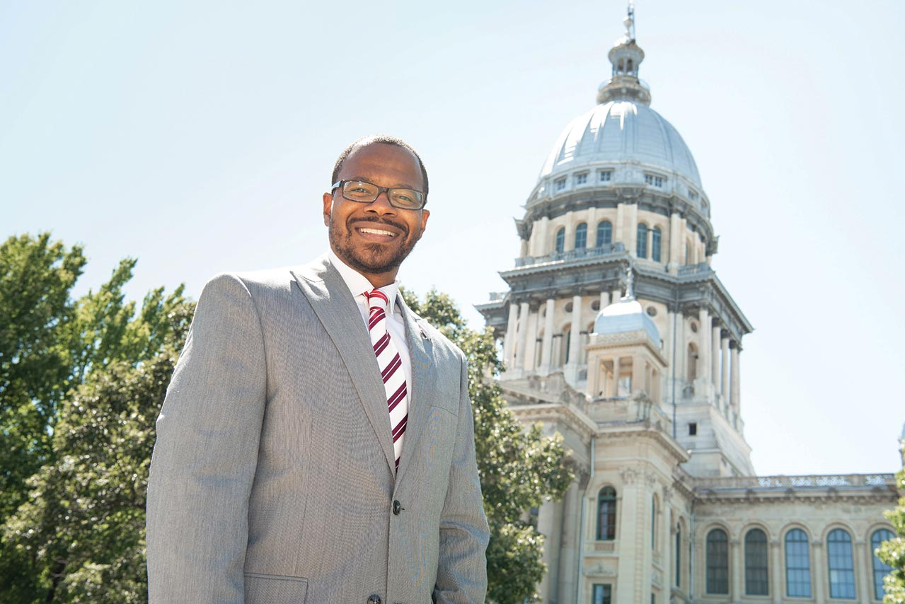 Dr. Jonathan Lackland smiles for a photo outside of the State of Illinois capitol in Springfield.