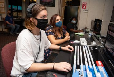Women work in studio.