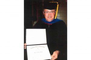 man with diploma