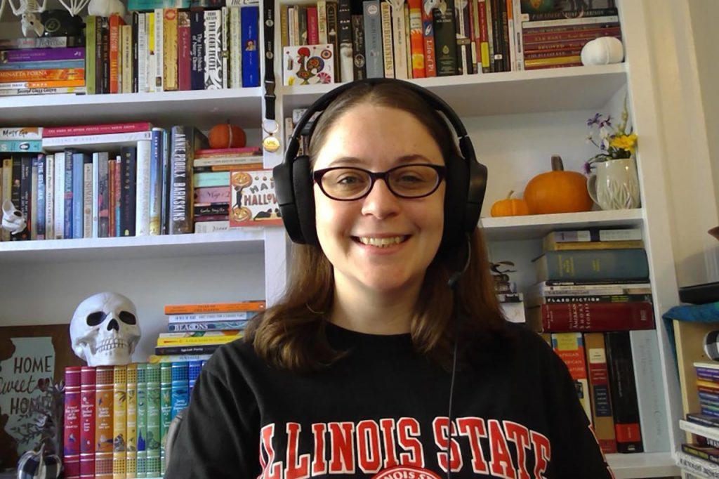 Department of English graduate student Heather O'Leary at her desk in her home office, where she teaches.