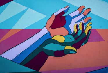 Colorful hands reaching out for help