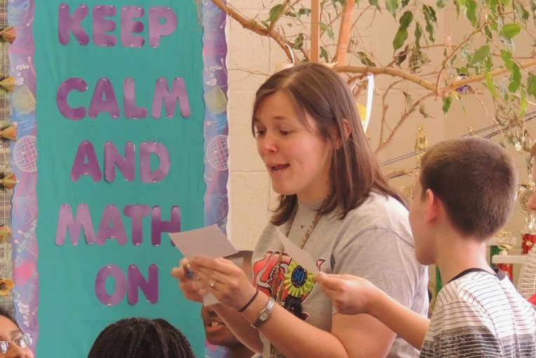 Jennifer Talbot in front of a banner that reads Keep Calm and Math On