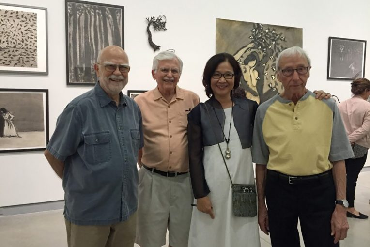 Photo taken at the fall 2016 exhibition Wonsook Kim: Lines of Enchantment. Left to right, Ken Holder, Harold Gregor, Wonsook Kim, and Harold Boyd. Wonsook Kim's artwork is installed on the walls of the University Galleries.