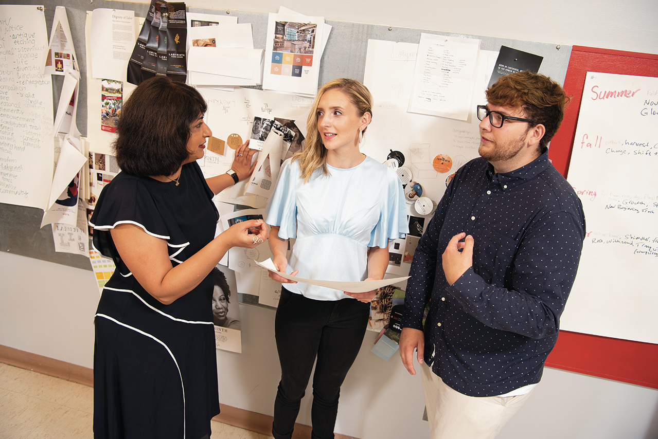 Design Streak Creative Director Archana Shekara consults with Micah Vetter '20 and Spencer Cadman in the studio.