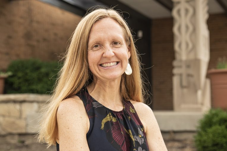 Dr. Katy Strzepek, Ph.D. '18, Director of the Center for Community Engagement and Service Learning, head shot