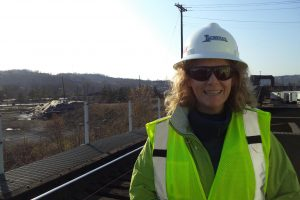 Woman in hard hat and highlight vest