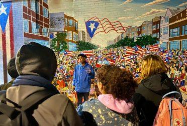 Tour guide giving tour of Paseo Boricua
