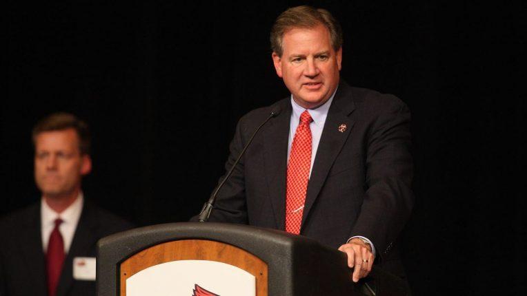 Larry Lyons speaking at a podium