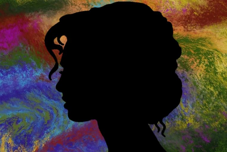 Artwork from TOP GIRLS program depicting a silhouette of a woman against a multi-colored background