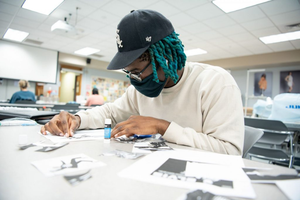 Student works on collaging