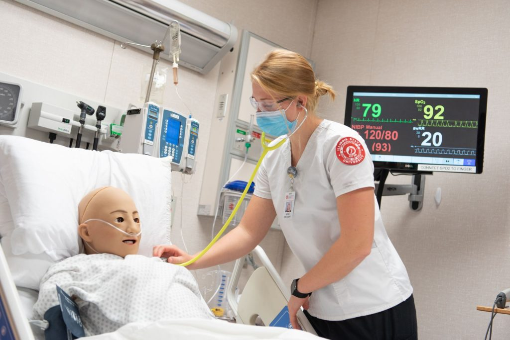 Female student works on a practice patient