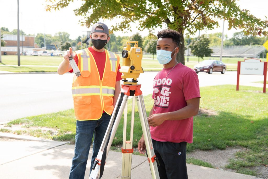 Engineering students survey a location