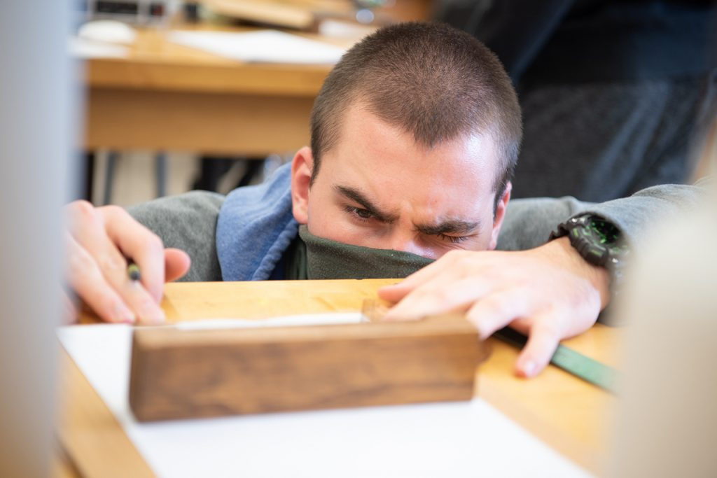 Student measures up a board