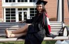 Hillary Campos in graduation regalia