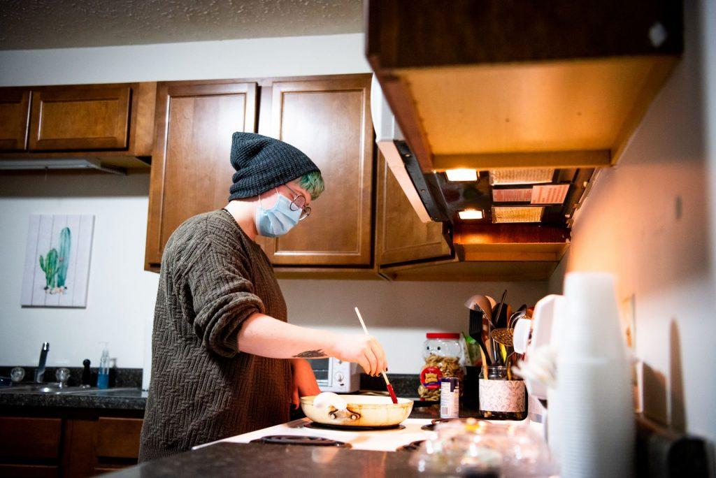 Chris Aaron cooks breakfast.