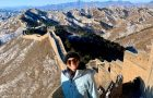 Study Abroad student poses in front of the Great Wall of China.