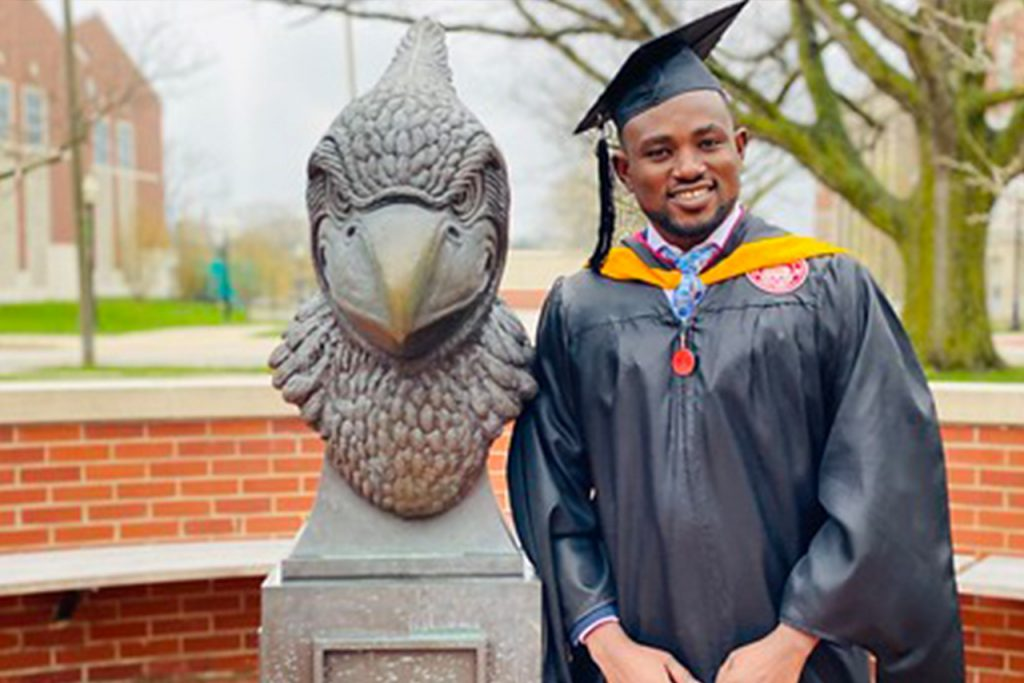Student in graduation regalia