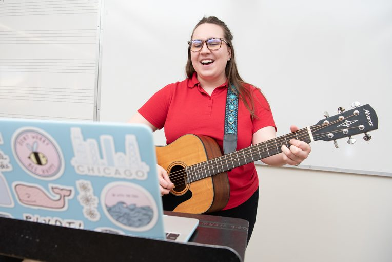 Music therapy graduate student Taylor Stengren conducting a telehealth session from a Centennial West classroom.