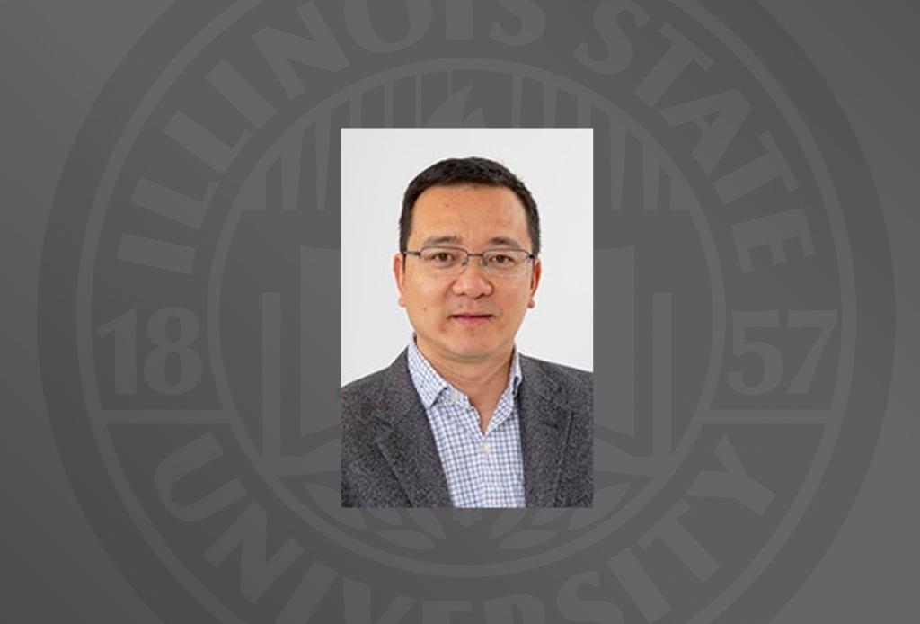 professor headshot on grey background