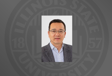 professor headshot on grey background