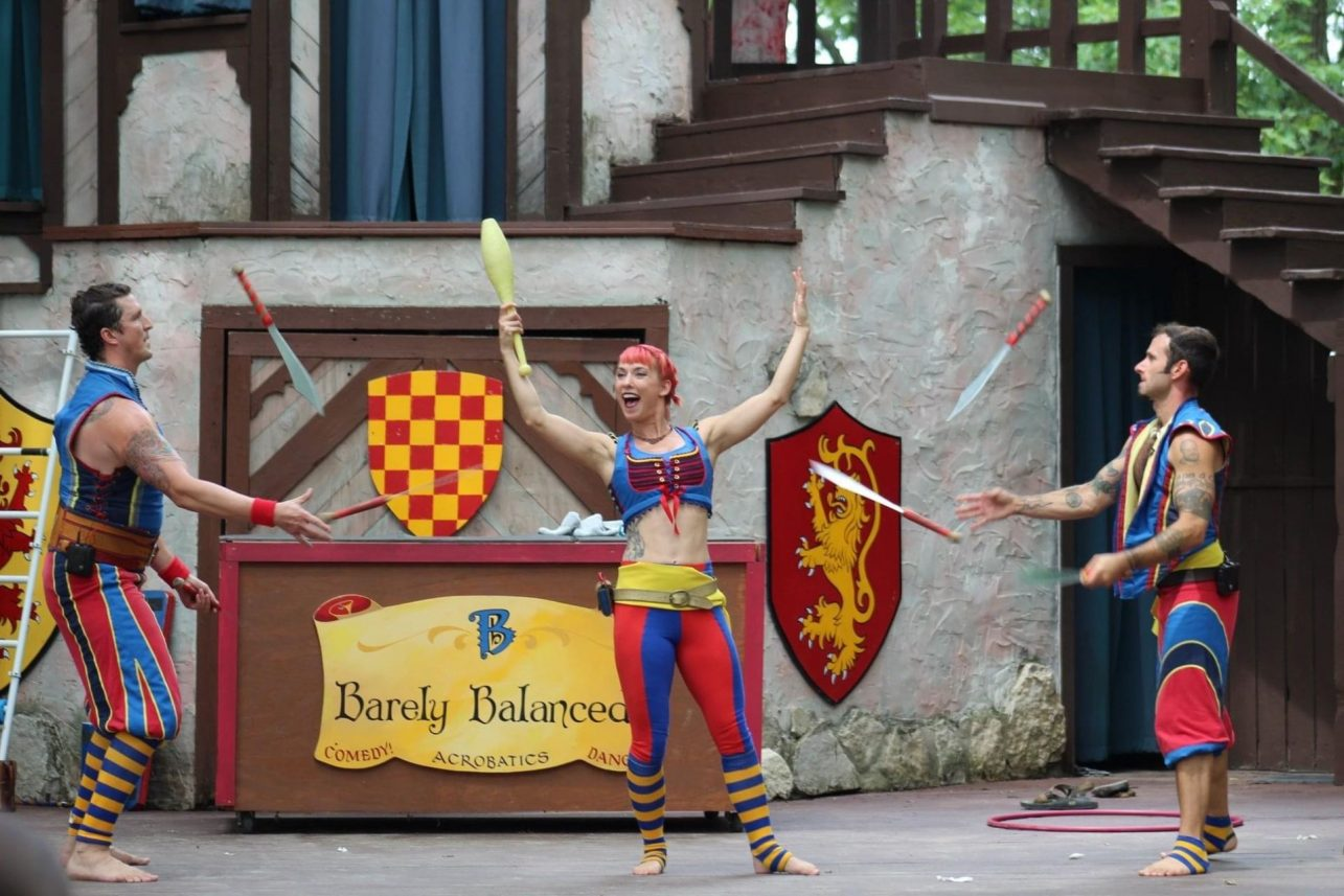 three performers juggling props