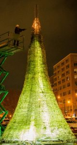 Photograph of giant glass Christmas tree being created by alum Jason Mack.