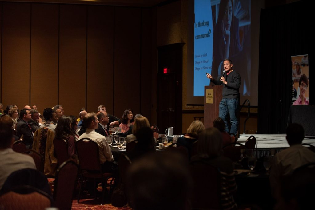 Keynote speaker on stage at the 2020 Symposium.