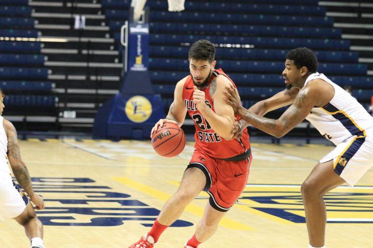 Basketball player dribbles toward the hoop