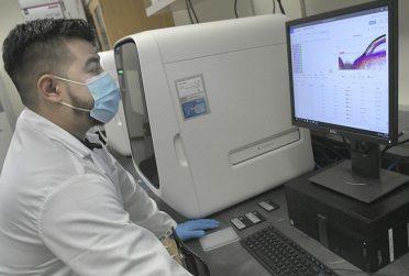 man wearing mask at computer