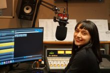 Student in radio station booth