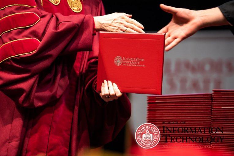 Graduating student receiving diploma