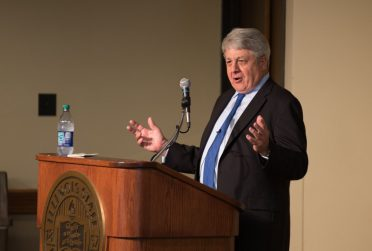 Man speaks at a podium