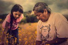 Indigenous women in a field
