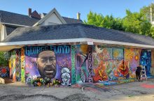 building covered with colorful mural honoring George Floyd