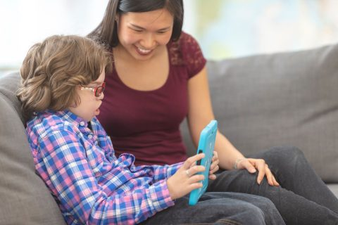 student and teacher using assistive technology